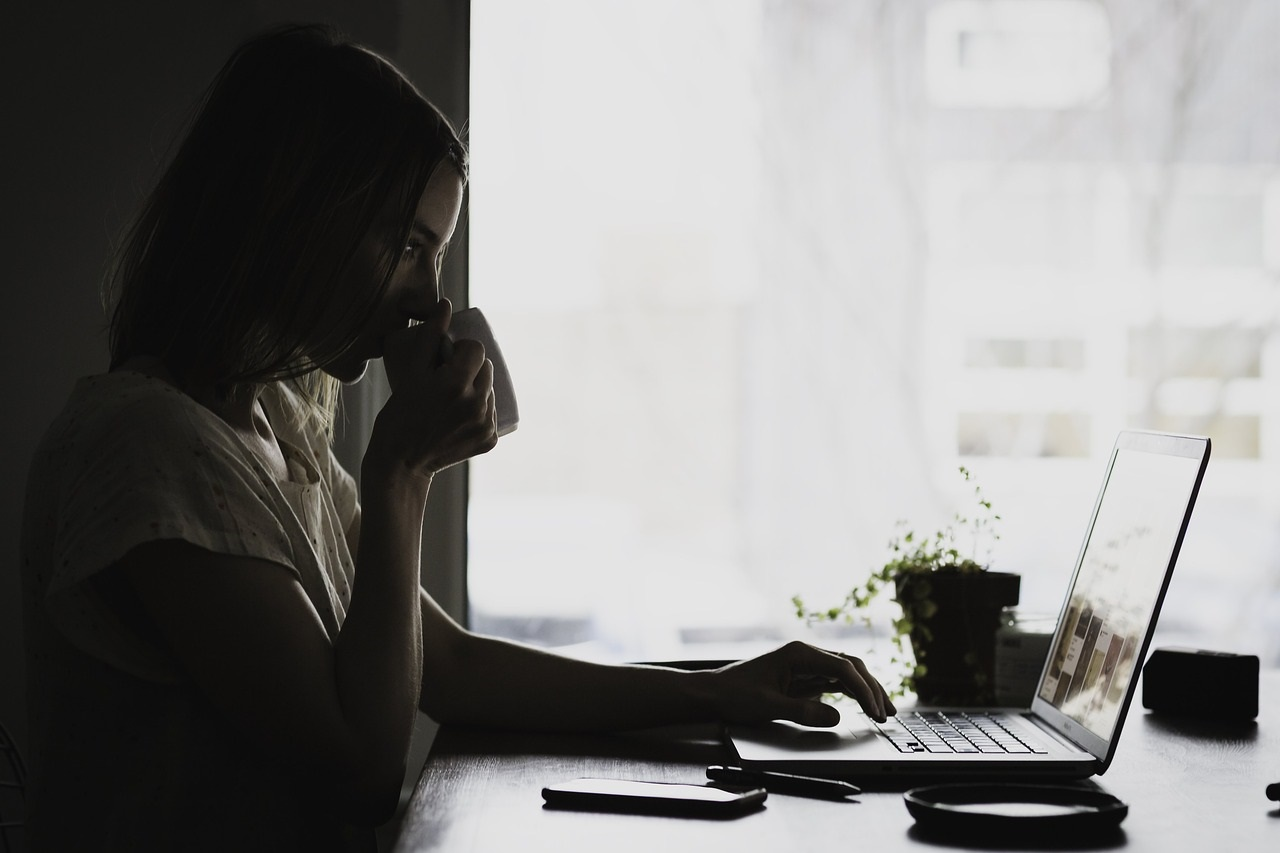Woman watching computer screen